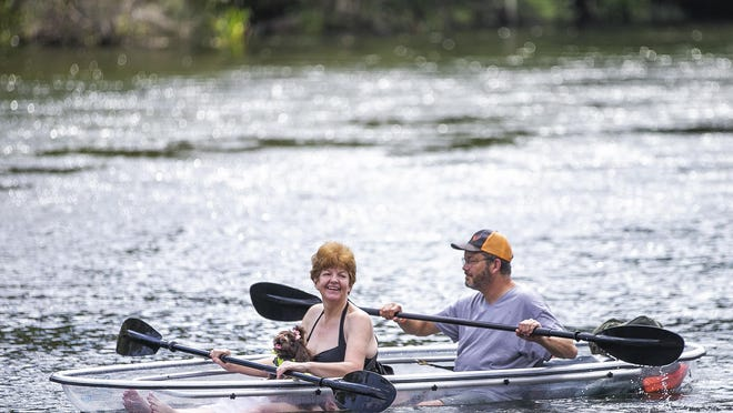 Becky and Rick Appard, along with their dog, kayak in a clear acrylic kayak on the Rainbow River  on October 22, 2019, at the Marion County Park in Dunnellon.