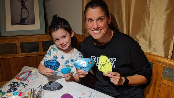 Sheri Arbige of Middletown and son Jaxon, 5, started Aquidneck Shells about a month ago. They paint seashells and hide them throughout the area.