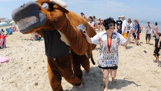 <137>The 18th annual Running of the Bull was held at the Starboard on Saturday in Dewey Beach, where<137> A bull, led by Elvis, chased a record crowd of partiers down Dewey Beach on Saturday for the 18th annual Running of the Bull. <137>and celebrate at the Restaurant and Bar with entertainment by Laura Lea & Tripp Fabulous.<137>