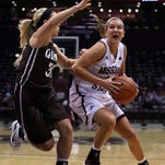 The Missouri State Lady Bears' Liza Fruendt drives to the basket against Quincy's Sarah Schumacher at JQH Arena in Springfield on November 8, 2015.