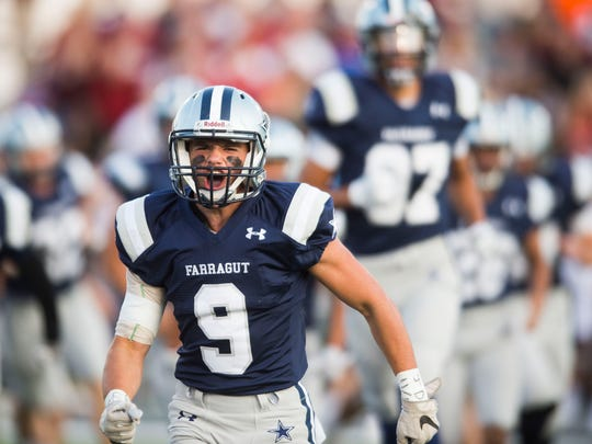 Farragut's Nathan Morgan (9) bursts through a Farragut