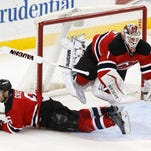 New Jersey Devils defenseman Andy Greene, bottom, wipes out teammate goalkeeper Keith Kinkaid during the third period of Friday's game, Friday in Newark, N.J. The Devils won 3-2 in a shootout.