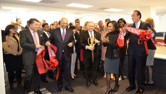 Sean Duffy, William C. Thompson, New York State Comptroller Thomas DiNapoli, CEO Suzanne Shank and Henry Cisneros, former Secretary of Housing and Urban Development, at the ribbon cutting ceremony Feb. 3, 2017. at the offices of Siebert Cisneros Shank & Co. in New York.