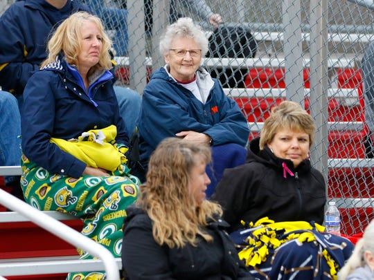 Fans try and remain warm while watching a matchup between the Wausau East and Wausau West softball teams last week at Wausau East.