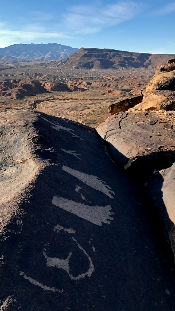 These petroglyphs can be found near the halfway point