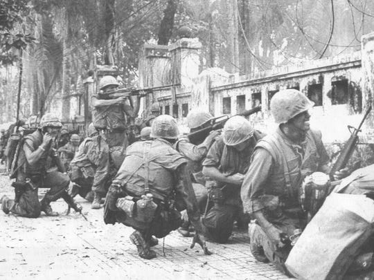 Marines battle North Vietnamese snipers during the battle for Hue in the Tet offensive in February  1968.