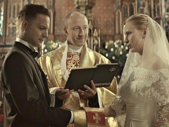 "A priest (Cezary Kosinski) officiates the wedding of Piotr (Itay Tiran) and Zaneta (Agnieszka Zulewska) in ""Demon."" It doesn't help matters."