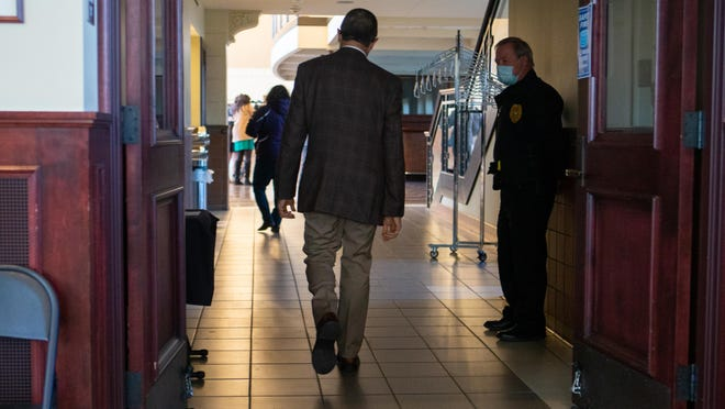 Shawnee County health officer Dr. Gianfranco Pezzino walks out of the Shawnee County Commission meeting Thursday morning after announcing he will resign at the end of the year. Pezzino was health officer for 14 years and said the past few months have been the most frustrating of his career.