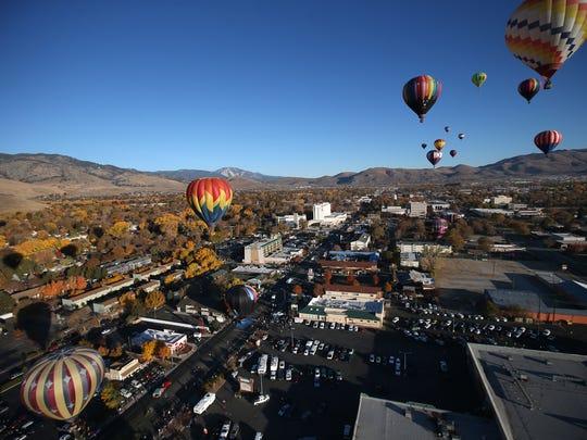 Hot-air balloons rise above Carson City.