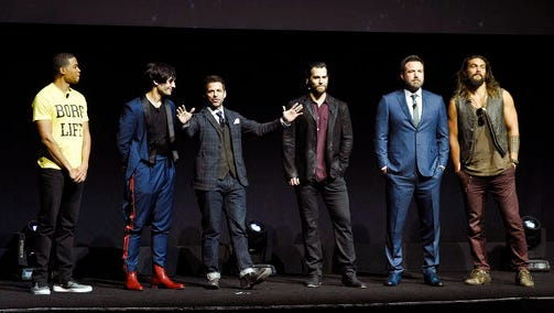 """Zack Snyder, center, director of the upcoming film """"Justice League,"""" addresses the audience with cast members, from left, Ray Fisher, Ezra Miller, Henry Cavill, Ben Affleck and Jason Momoa during the Warner Bros. Pictures presentation at CinemaCon 2017 at Caesars Palace on Wednesday, March 29, 2017, in Las Vegas."""