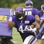 Minnesota Vikings running back Adrian Peterson carries the ball during a July 28 practice at an NFL training camp on the campus of Minnesota State-Mankato in Mankato.