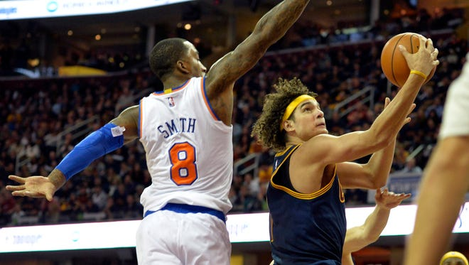 Cleveland Cavaliers center Anderson Varejao (right) has a new deal.