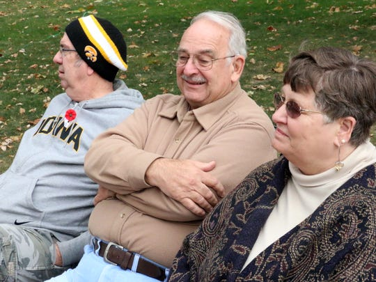 From left, Mount Pleasant residents Mike Gardner, Rich Sankey and Joann Sankey watch as a memorial fountain to late Mount Pleasant Mayor Edd King is dismantled in downtown on Wednesday, Oct. 21, 2015. The fountain will be refurbished over the winter in Alabama. Joann was shot and injured in the same shooting at a 1986 city council meeting that was the site of King's killing.