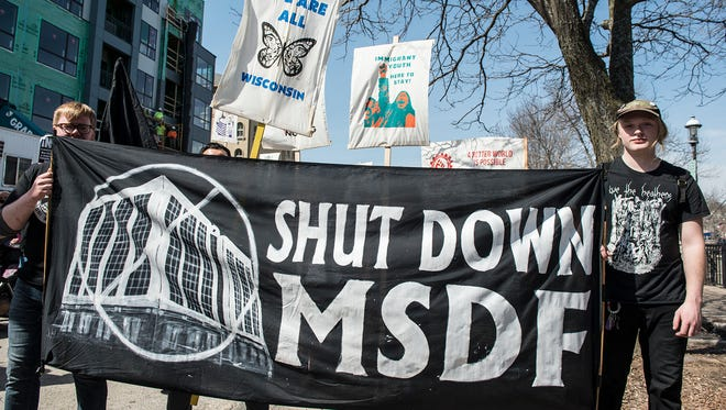 Protesters demand that the Milwaukee Secure Detention Facility be closed during a May Day rally in Waukesha earlier this year.