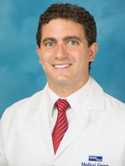 Dr. George Collis is a Health First Breast Center plastic and reconstructive surgeon.