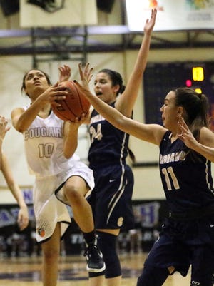 Franklin's Cierra Winters, 10, drives for a shot under pressure from Coronado's Abigail Bumgardner, 24, and Laura Milliorn, 11, last season. Winters has verbally committed to play basketball for the Air Force Academy next season.