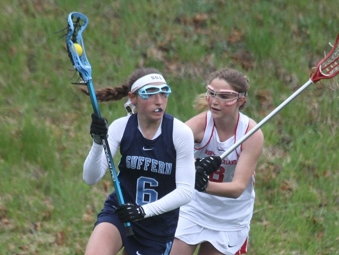 Suffern's Hannah Newman is pressured by  North Rockland's Kaitlyn Rau during their game at North Rockland April 29, 2014. Suffern won 18-8.