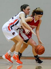 In this file photo, Sarah Sepic of Central York, left, covers Taylor Tannura of Susquehannock. Sepic returns to the Panthers as the team's leader in 3-pointers made during the 2016-17 season. John A. Pavoncello - The York Dispatch