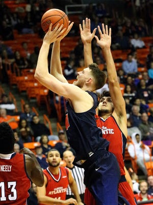 UTEP center Matt Willms shoots past the outstretched arms of William Pfister of Florida Atlantic Saturday night in the Don Haskins Center.