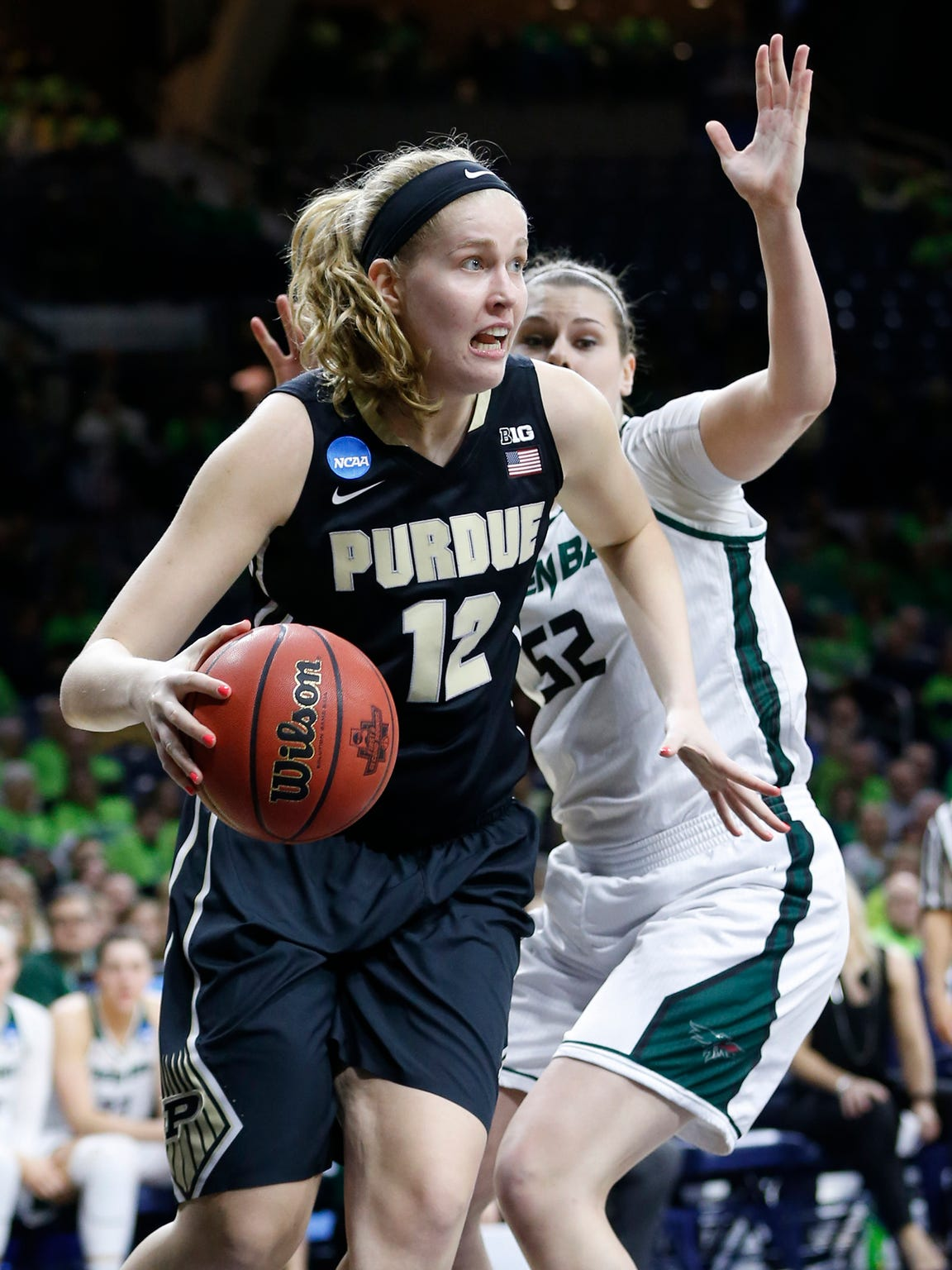 Nora Kiesler gets around Madison Wolf of Green Bay in the first round of a 2017 NCAA tournament victory at Notre Dame.
