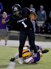 Trinity Christian's Viktor Horton is grabbed by the foot by a Union City defender during their game, Friday, September 29.