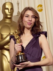 """Writer and director Sofia Coppola holds the Oscar she won for best original screenplay for her work on """"Lost in Translation"""" at the 76th annual Academy Awards Sunday, Feb. 29, 2004, in Los Angeles."""