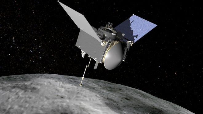 Artist rendering of NASA's OSIRIS-REx spacecraft at the asteroid Bennu.