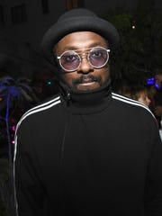 "Black Eyed Peas musician will.i.am has accused a Qantas flight attendant of being ""overly aggressive,"" racist and rude on a flight."