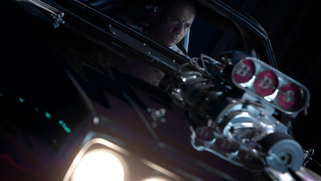 """Vin Diesel reprises his role in the fast cars action thriller """"Furious 7."""""""