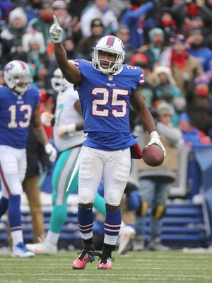 Bills running back LeSean McCoy signals a first down against Miami.
