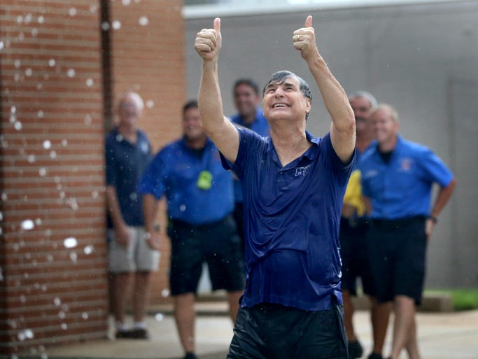 Murfreesboro Vice Mayor Doug Young gives a thumbs up to the fire fighters in the bucket truck that sprayed Murfreesboro City employees and their families during the ice bucket challenge, after Young participated in the challenge, at the Murfreesboro Fire & Rescue Station on  Vine Street , on Wednesday August  20, 2014. The challenge is used to raise money for ALS.