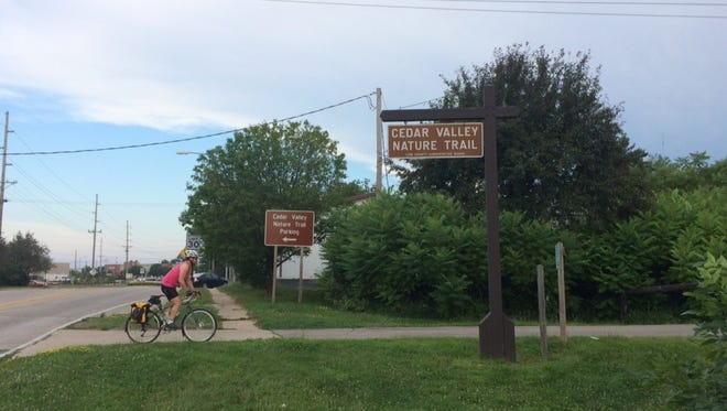 A RAGBRAI cyclist pedals along the Cedar Valley trail out of Hiawatha Friday morning.