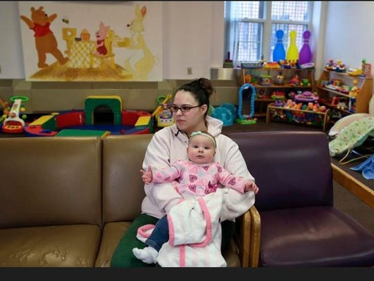 Jennifer Dumas answers questions during an interview while holding her daughter, Codylynn, in a playroom at Bedford Hills Correctional Facility, in Bedford Hills, In this April 12, 2016 photo. Bedford Hills has one of only eight working prison nurseries where women live with their babies, out of more than 100 women's prisons around the country.