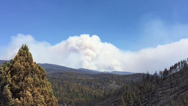 Smoke rises over the Canyon Creek Complex Fire.