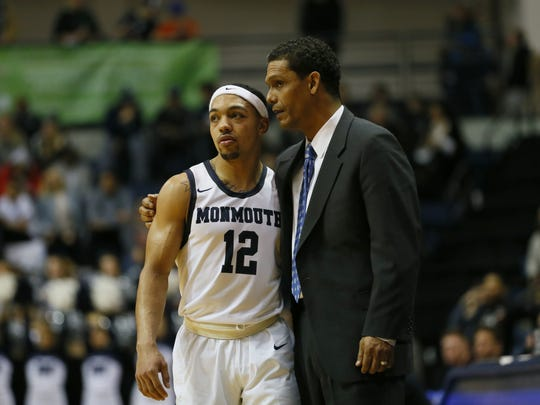 Noah K. Murray/Correspondent Monmouth  head coach King Rice (right) talks to guard Justin Robinson  during the second half against Iona on Friday. Monmouth won 92-74 to break a three-game losing streak. Monmouth Hawks head coach King Rice talks to Monmouth Hawks guard Justin Robinson (12) during second half at Monmouth University. West Long Branch,NJ. Friday, January 6, 2017. Monmouth Hawks defeated Iona Gaels 92-74.Noah K. Murray-Correspondent/Asbury Park PressASB 0107 Monmouth Basketball