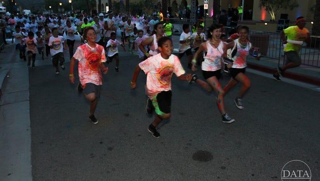 Neon-splattered runners participate in last year's Desert Glow Fest race.
