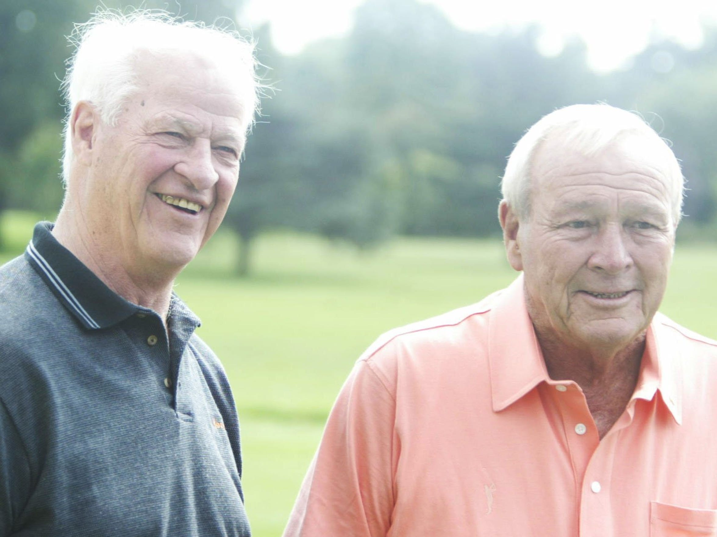 Gordie Howe, left, and golf legend Arnold Palmer at the Arnold Palmer-Turning Point Invitational at the Country Club of Detroit in Grosse Pointe on Aug. 30, 2004.