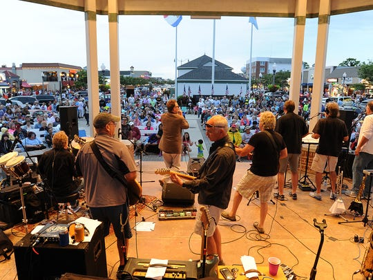A huge crowd was on hand to listen to local band The Funsters at the Bandstand and to view the pyrotechnics as the Annual Rehoboth Beach Fireworks were shot off on Sunday Evening July 3rd from the beach.