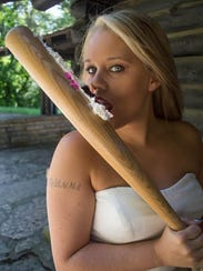 Catherine Marie Meisenburg takes a baseball bat to