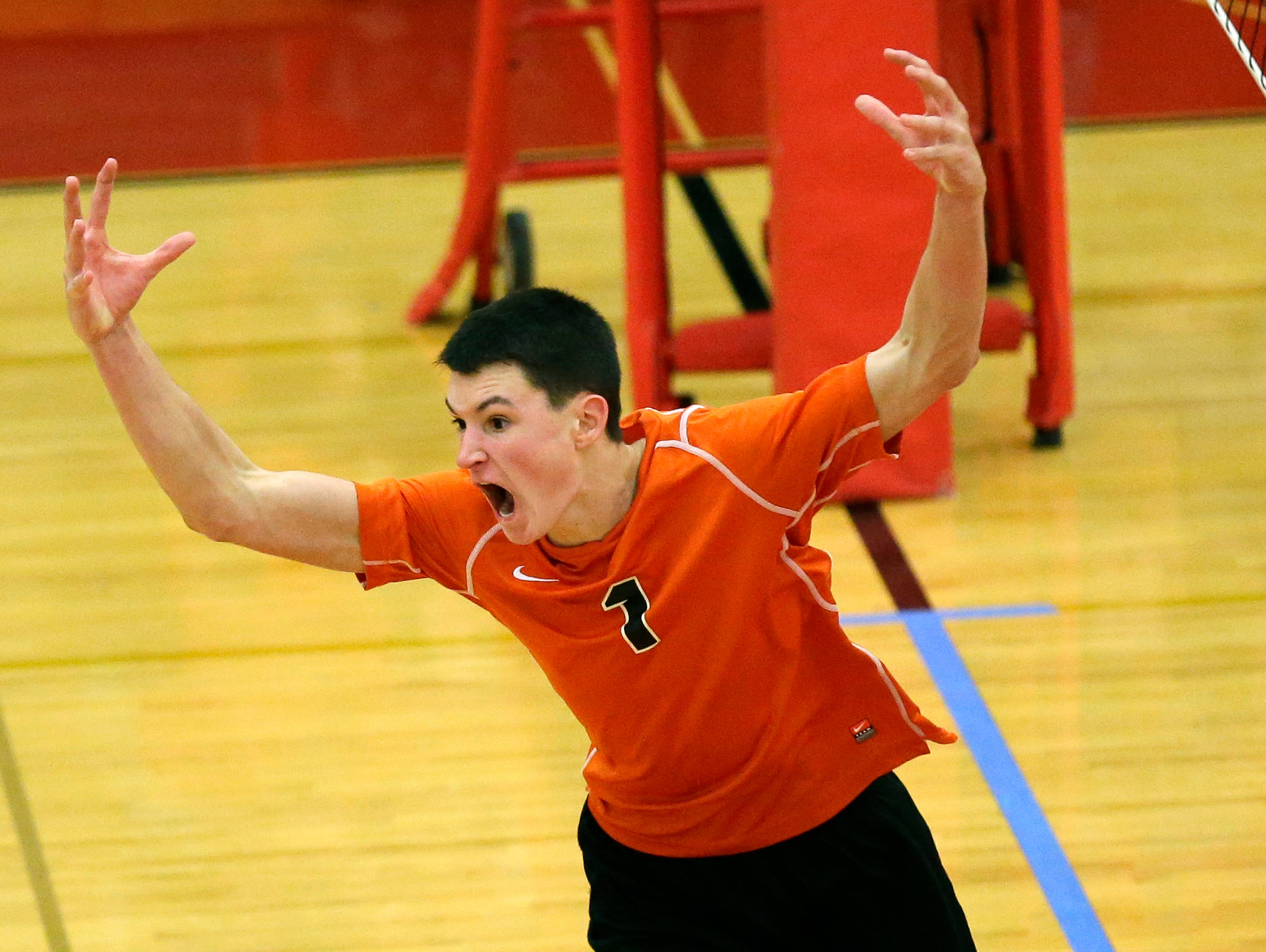 Kaukauna High School's Bailey McDaniel celebrates after defeating Appleton North High School during their WIAA boys volleyball sectional championship match Thursday at Kimberly High School.