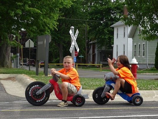 Wyatt Stahl waits at a railroad crossing Friday at Safety Town, much to the dismay of Ana Wilburn. The kindergartners learned much about driving laws during the week-long class.