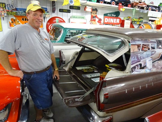 Hank Davis stands with his Edsel Bermuda, one of only