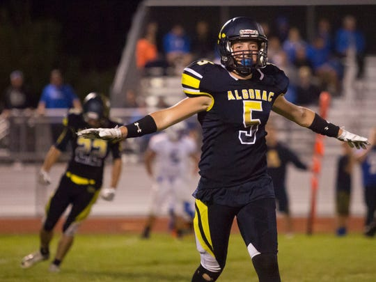 Algonac's Dominic Dobrenich celebrates a play during a football game Friday, September 23, 2016 at Algonac High School.