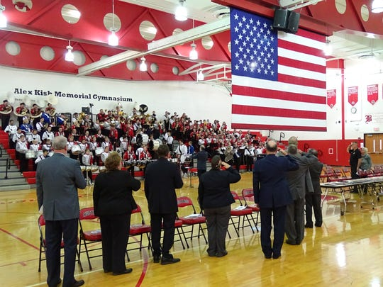 The crowd stands at attention Friday as the national anthem is played during the Crawford County Veterans Hall of Fame induction ceremony at Bucyrus High School.