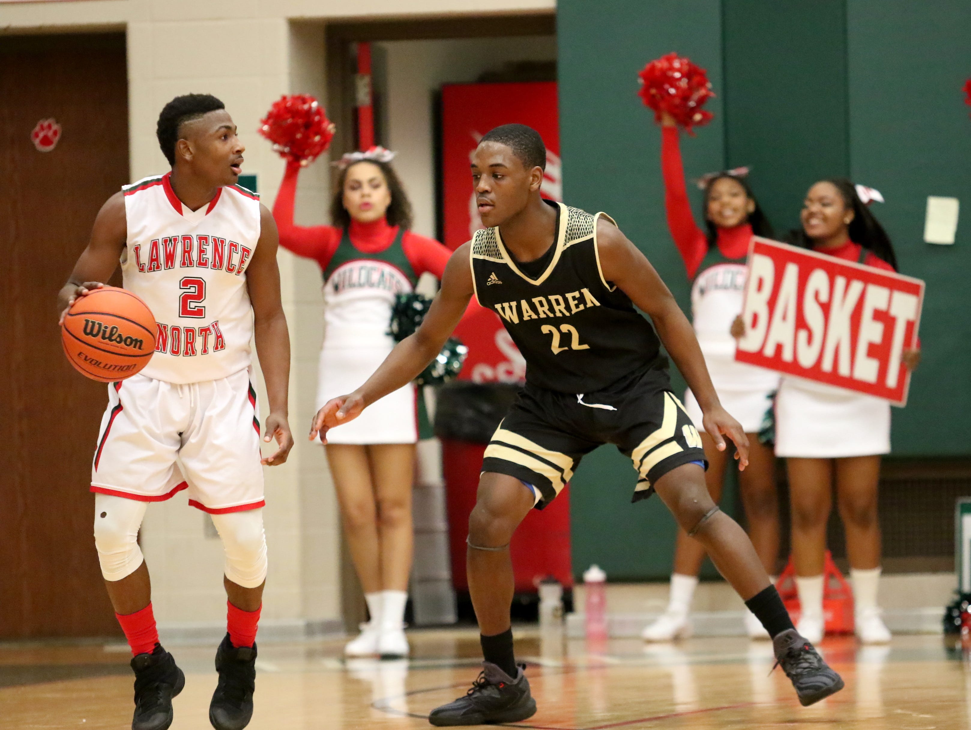 Warren Central's David Bell guards Lawrence North's Antwaan Cushingberry during Friday night's game in Indianapolis.