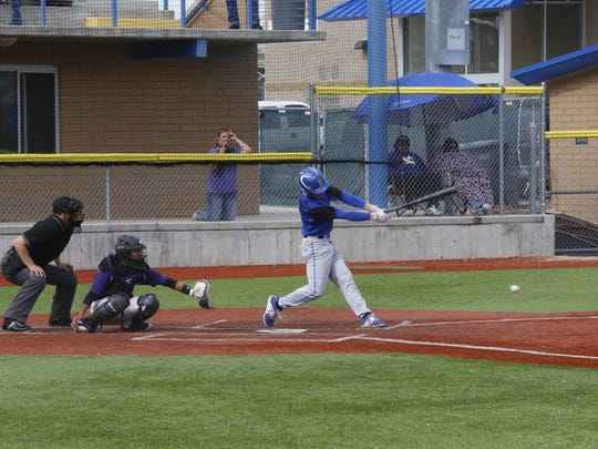 Bloomfield's Nolan McKim connects on a pitch against Kirtland Central on Thursday at John Gutierrez Field in Bloomfield.
