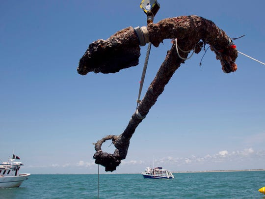 A 3,000-pound anchor from Blackbeard's Queen Anne's Revenge is recovered from the ocean off the coast of North Carolina, where it has been since 1718, Friday, May 27, 2011.