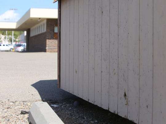 A shed outside the medical office of physician David Dunn at 505 E. 20th St. in Farmington was damaged during a detonation of an explosive device early Tuesday morning.