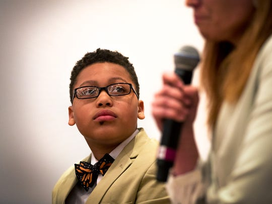 Alex Hart-Upendo, a student at Gifford Elementary School, listens last year as Rep. Amanda Stuck answers a question during a Kids in Crisis event in May. Students and lawmakers will again discuss mental health at an event March 22 at Marquette University.