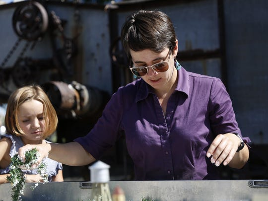 San Juan Soil and Water Conservation District manager Melissa May rearranges objects in a watershed demonstration trailer Tuesday as Kassandra Durham watches during an Aztec Through Time children's camp at the Aztec Museum and Pioneer Village.
